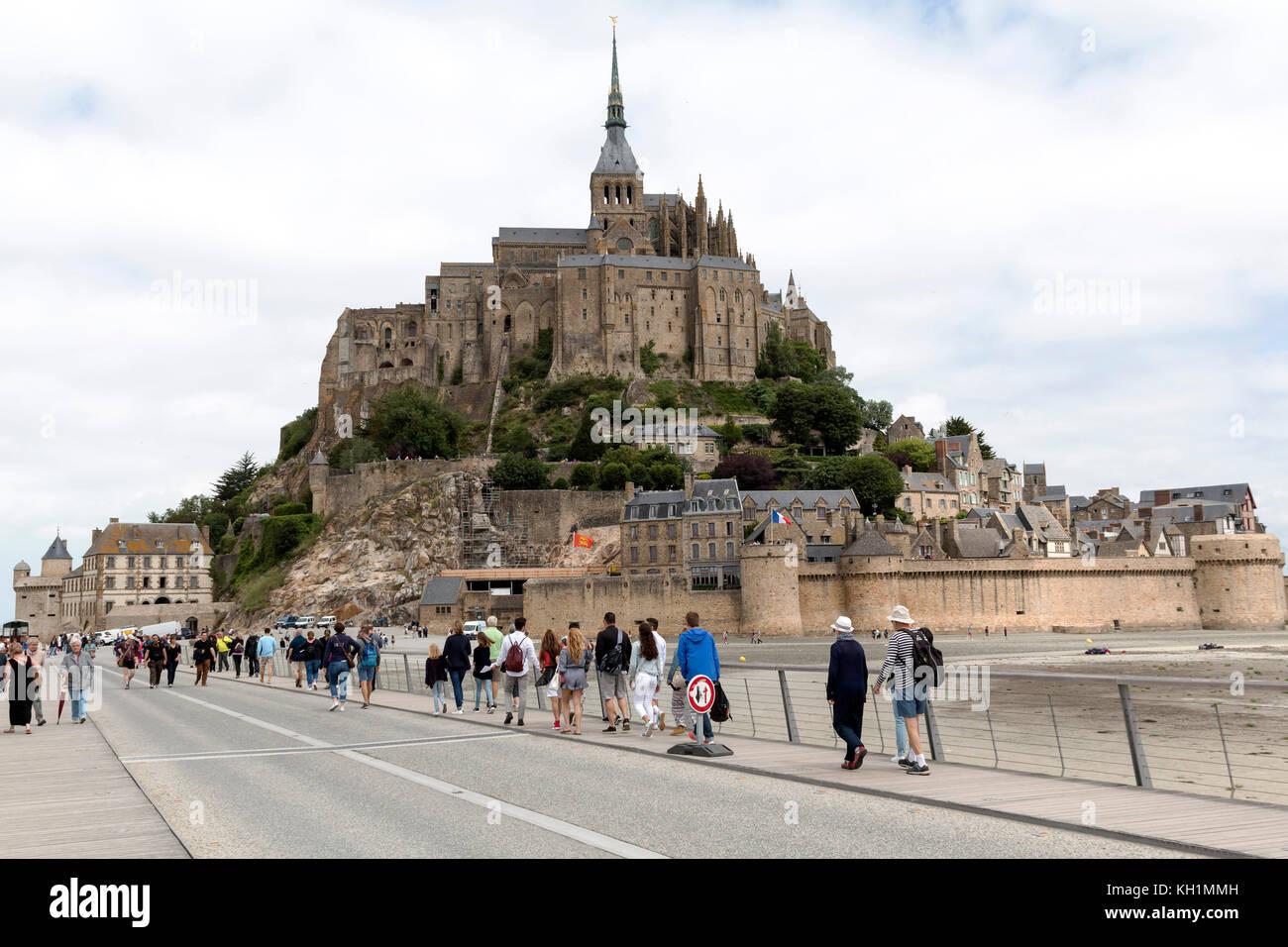 Mont Saint-Michel, Normandy, France - July 3, 2017: Tourists visiting island commune fortress Mont Saint-Michel Stock Photo