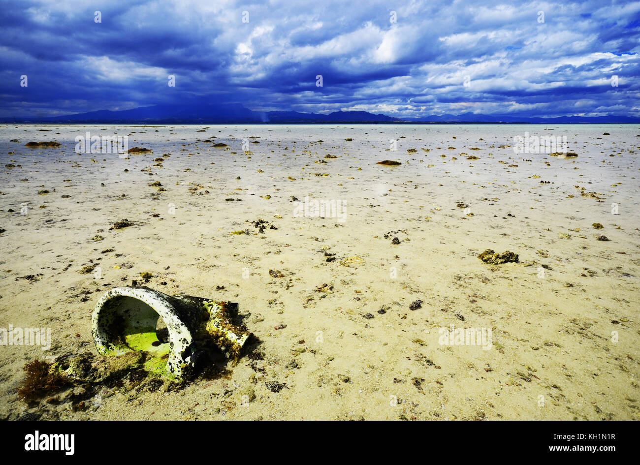 Toilet on ocean floor at uninhabited island near Fiji with storm in background - Stock Image
