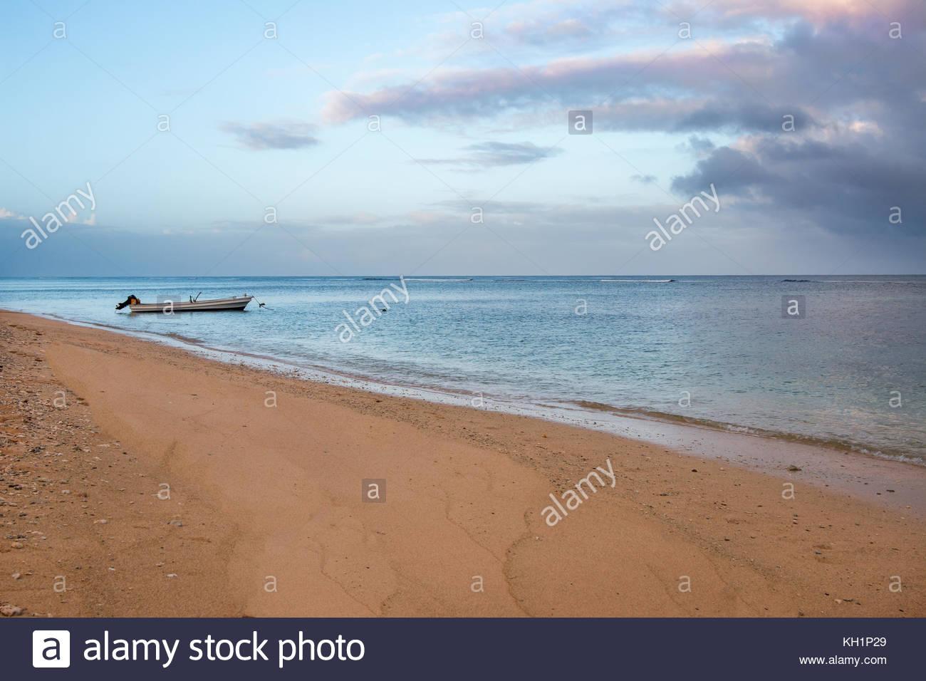 Boat anchored on a beach, Tonga - Stock Image