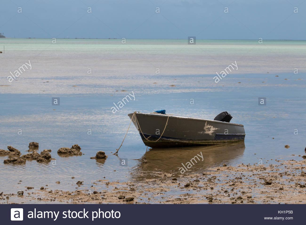 Old wooden boat on shallow water, Tongatapu Island, Tonga - Stock Image