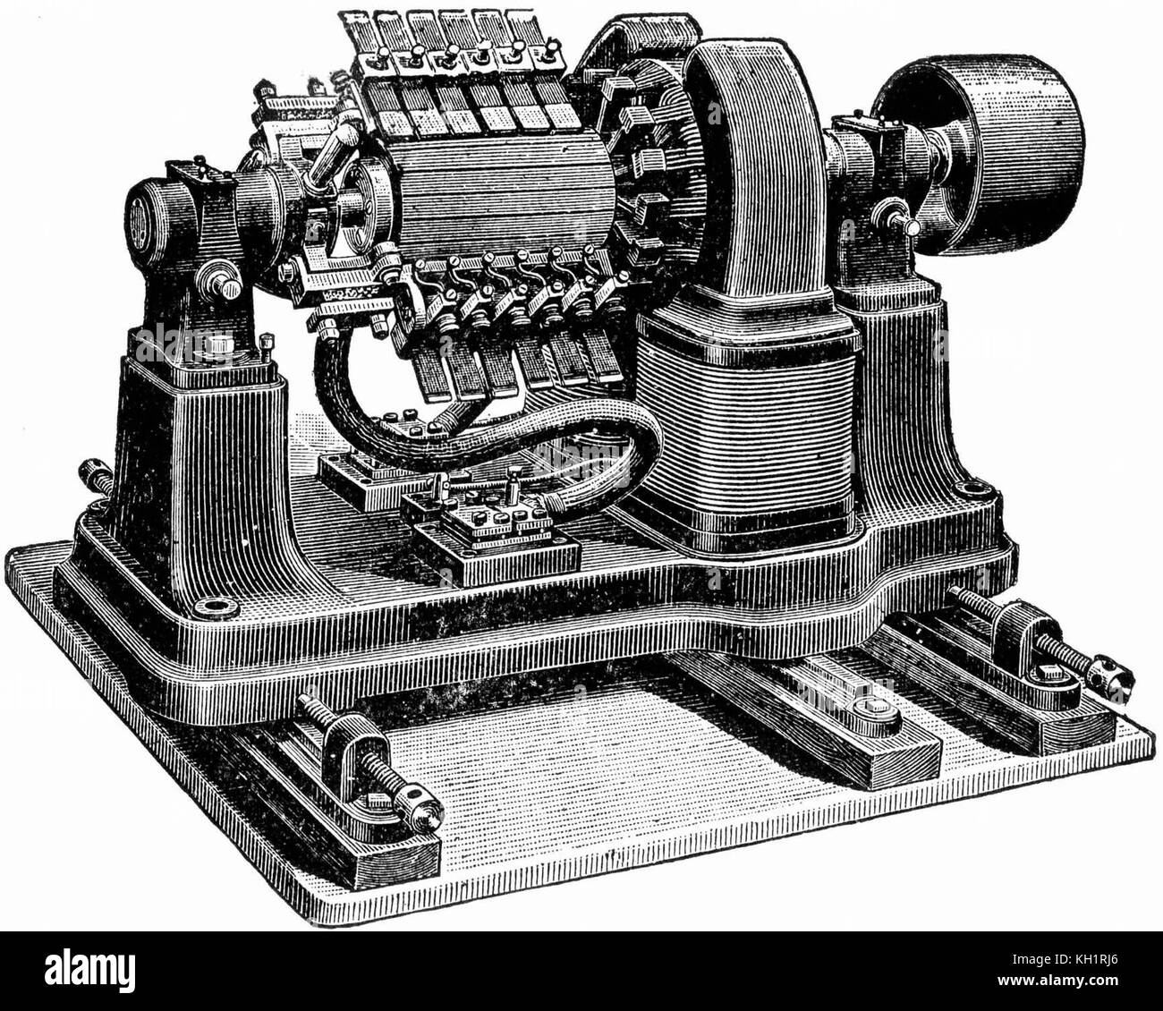 This large belt-driven high-current dynamo from around 1917 produced 310 amperes at 7 volts DC. The huge complicated - Stock Image