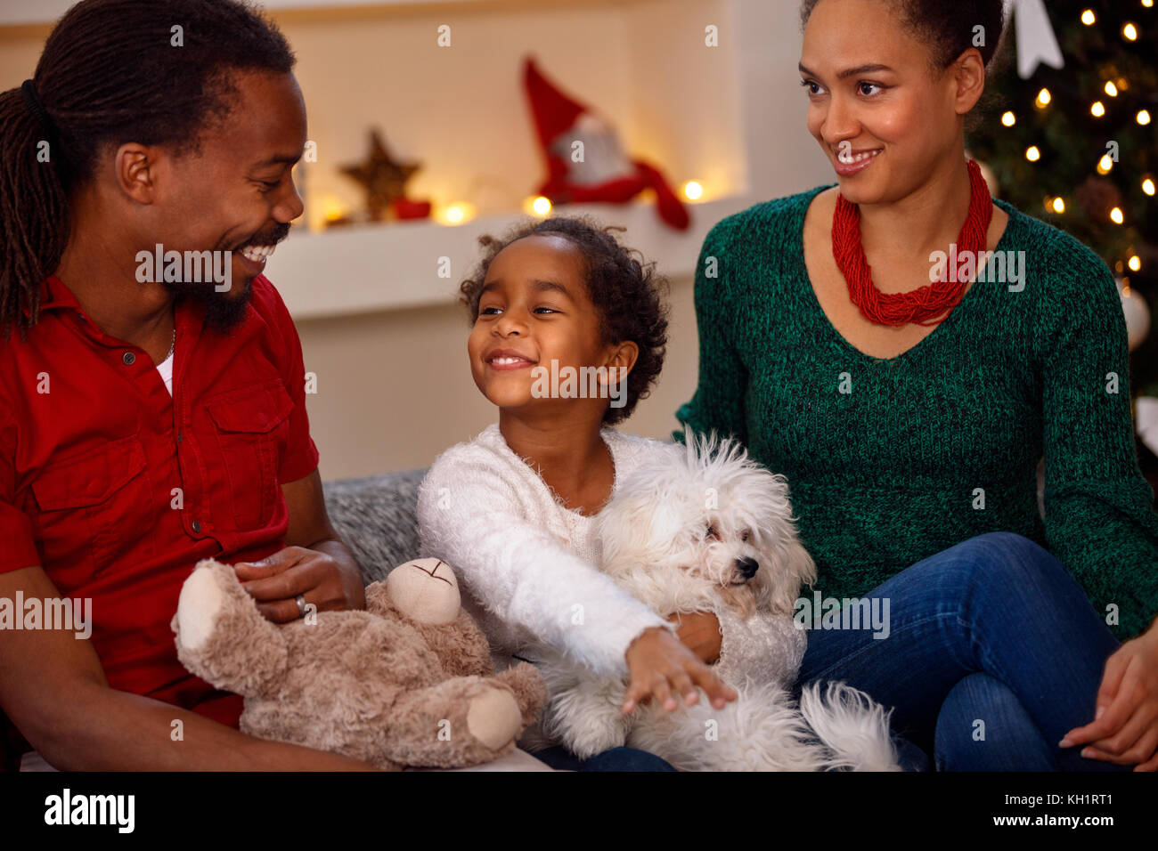 young smiling black family with presents at christmas stock image - Black People Christmas