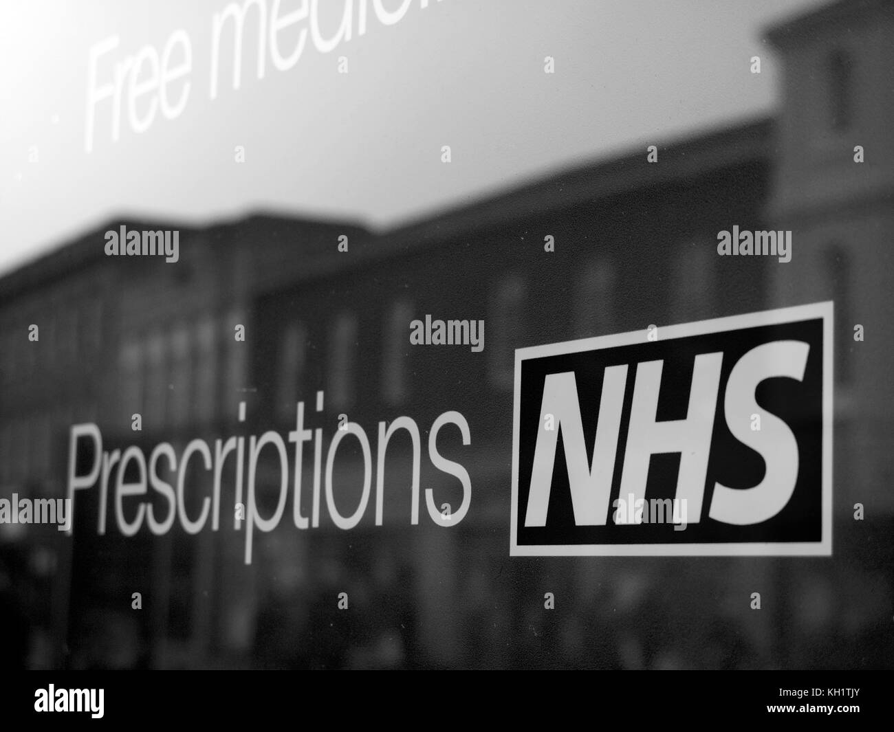 National Health Service prescriptions sign in pharmacy shop window - Stock Image