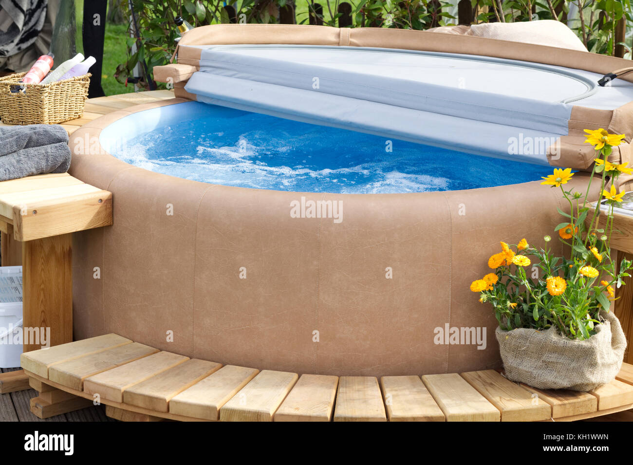 hot tub with wooden decking in the garden stock photo 165384737 alamy. Black Bedroom Furniture Sets. Home Design Ideas