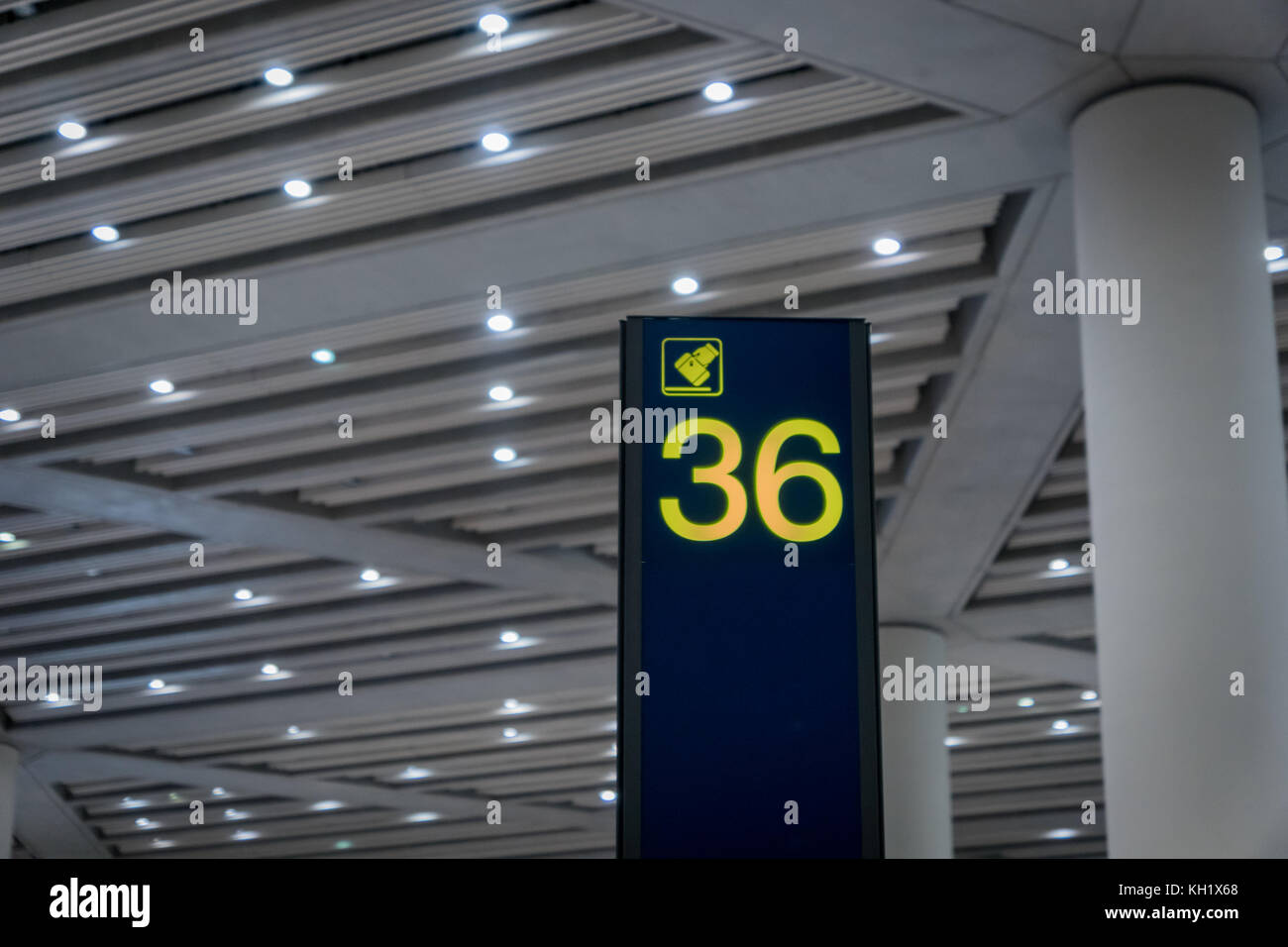 Airport arrival area baggage claim number sign board in departure area - Stock Image