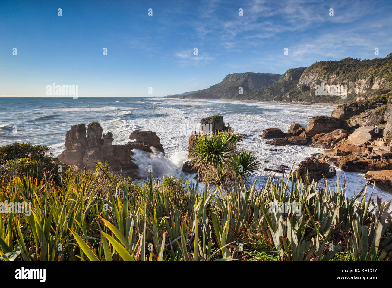 The incoming tide pounding on the rocky shoreline at Punakaiki, in the Paparoa National Park on the West Coast of - Stock Image