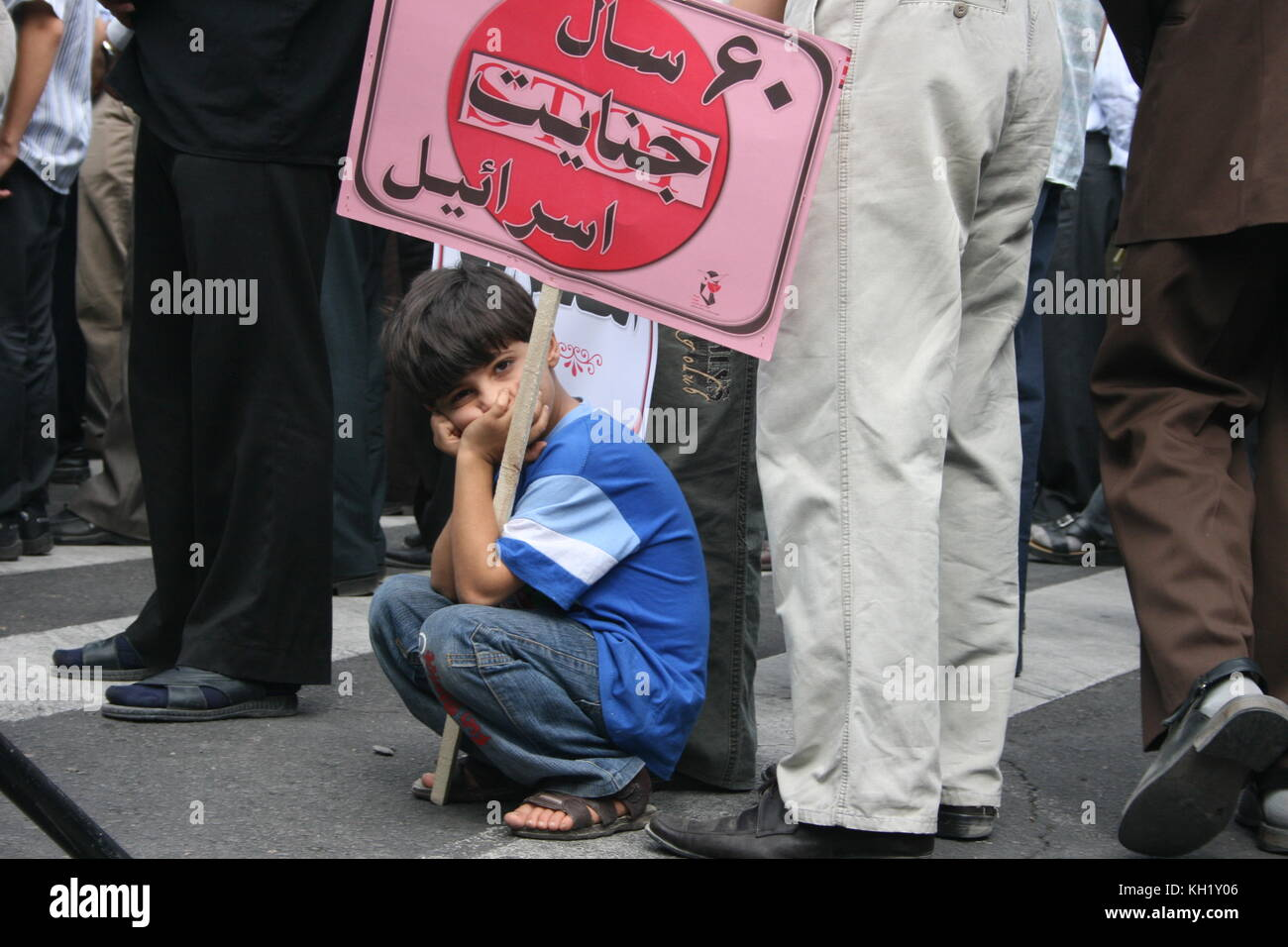 A child on anti Israel demonstrators in Tabriz, Iran , he looks frastrated in crawde - Stock Image