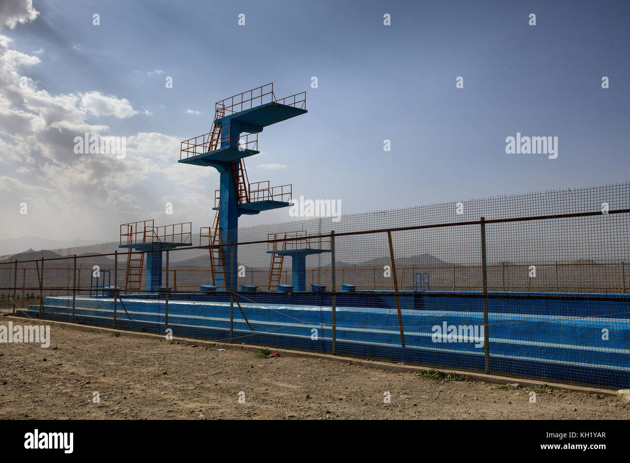 Kabul - Diving Boards and olympic-sized swimming pool built by the Russians in bid for Olymic Games. The pool was - Stock Image