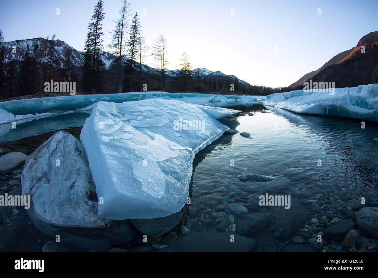 glacier ice melts in the spring on the river in the mountains. - Stock Image