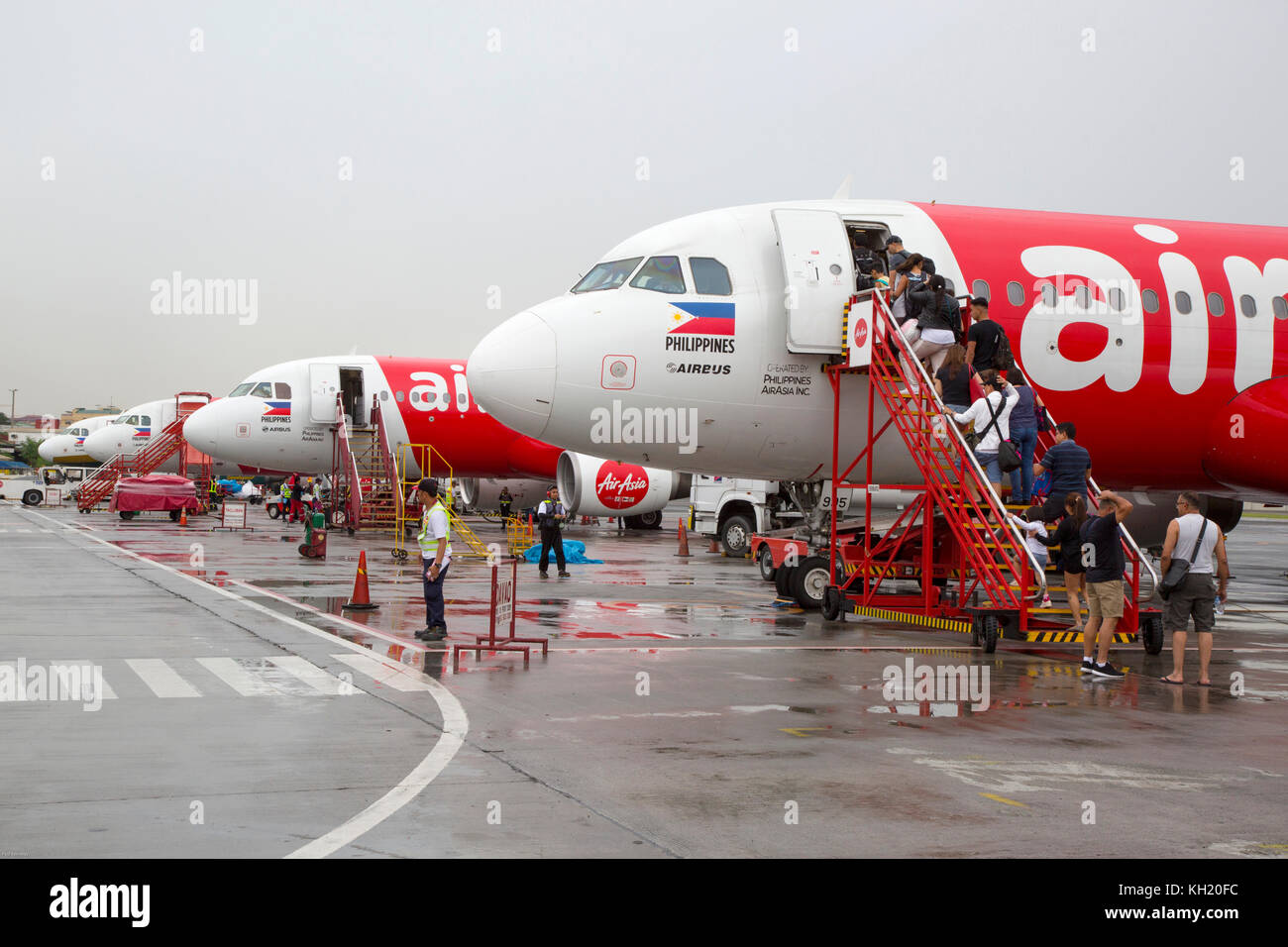 Passengers boarding Air Asia aircraft at Manila airport, Philippines - Stock Image
