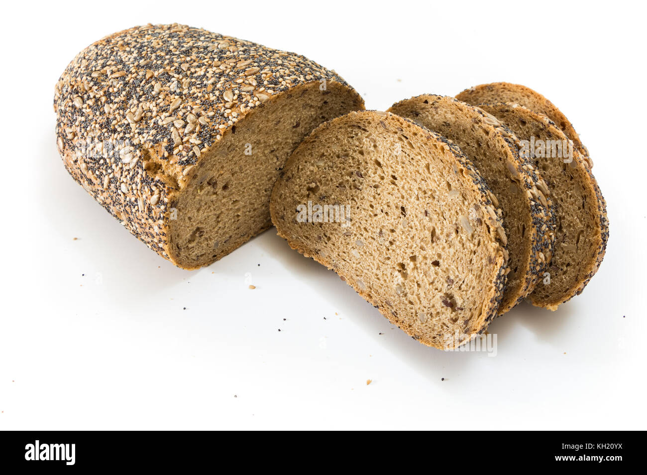 Whole wheat bread with seeds sliced, on white background. Stock Photo