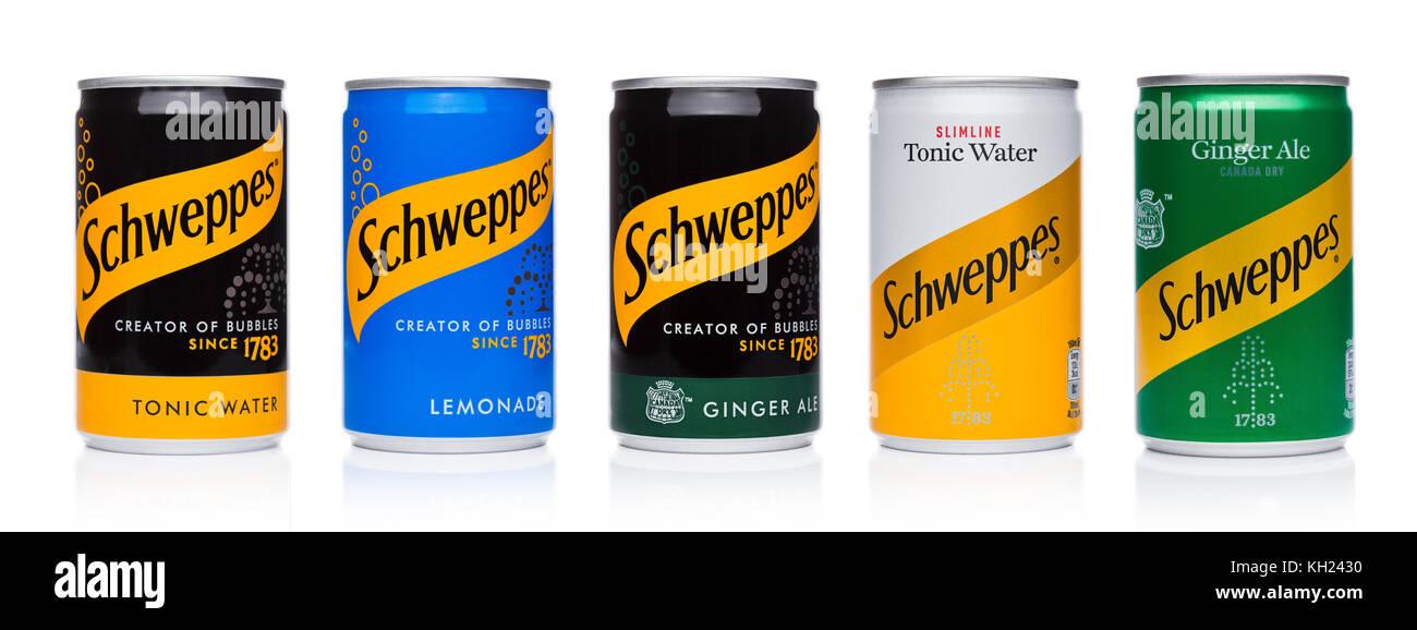 LONDON, UK - NOVEMBER 10, 2017: Schweppes tins soda drinks taste on white background.The Dr Pepper Snapple Group - Stock Image