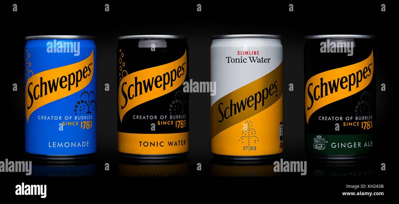LONDON, UK - NOVEMBER 10, 2017: Schweppes tins soda drinks taste on black background.The Dr Pepper Snapple Group - Stock Image
