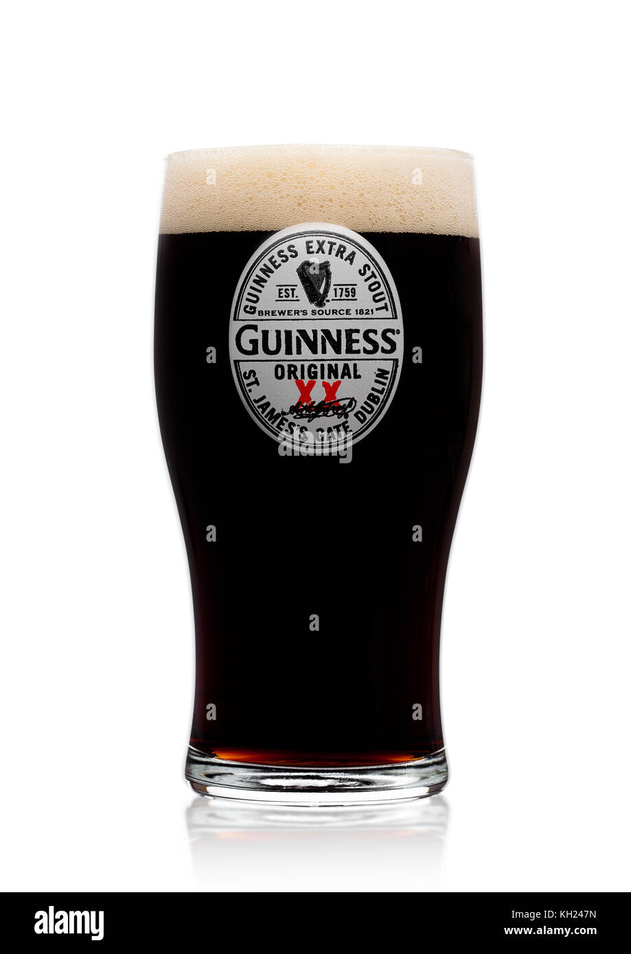LONDON, UK - NOVEMBER 10, 2017: Glass of Guinness original beer on white background. Guinness beer has been produced - Stock Image