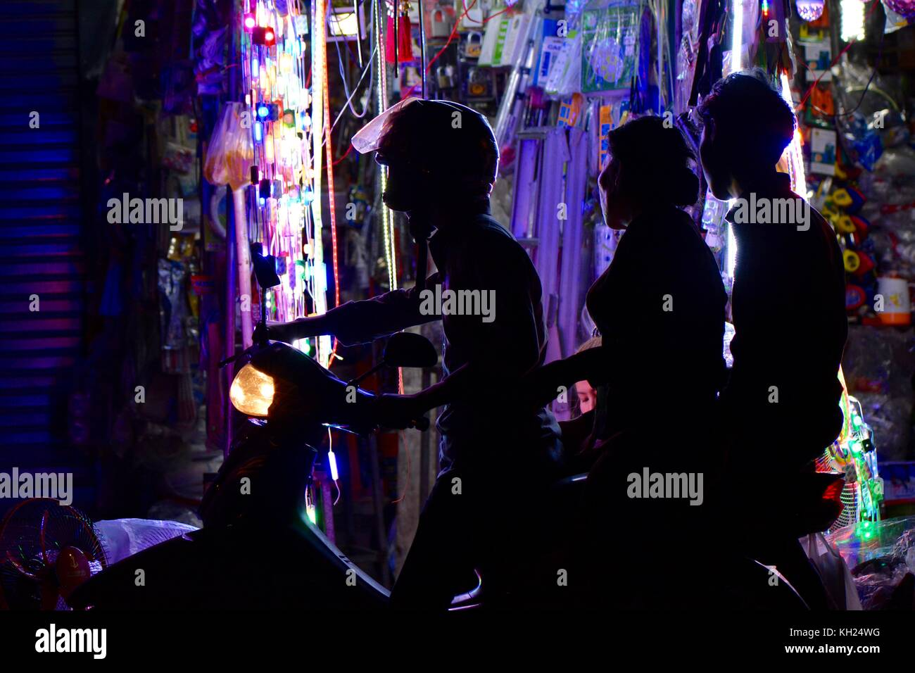 Waiting at a street stall, Phnom Penh - Stock Image