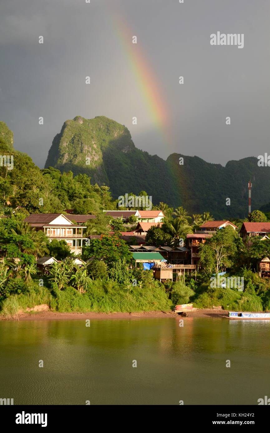 Rainbows above Nong Khiaw, Laos, in the early evening light Stock Photo