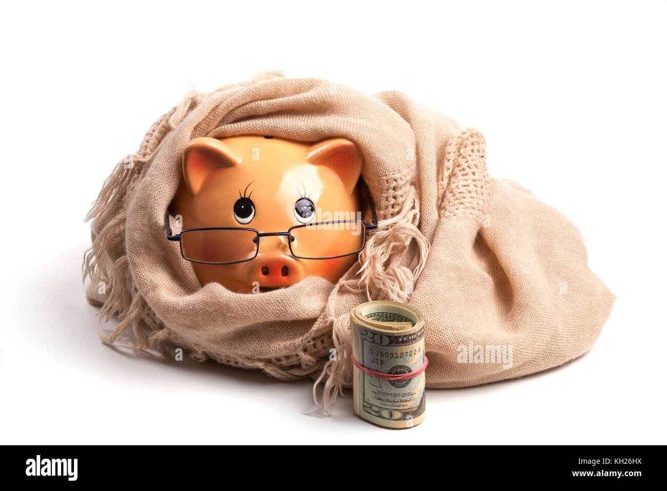 Piggy Bank Wearing Scarf, Isolated on White Background.Saving Heating Concept - Stock Image