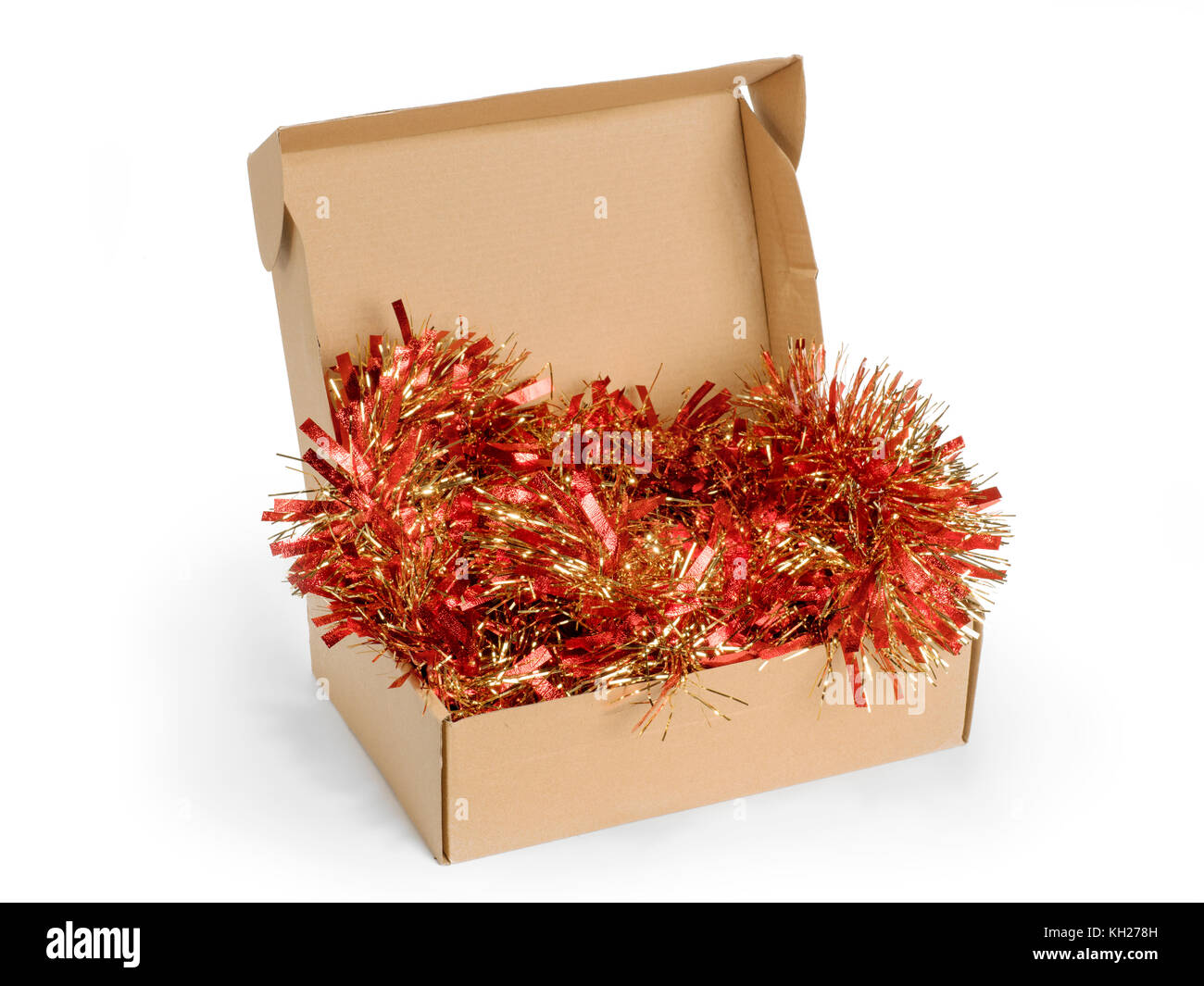 cardboard box with christmas tinsel isolated on white stock image - Cardboard Box Christmas Decorations
