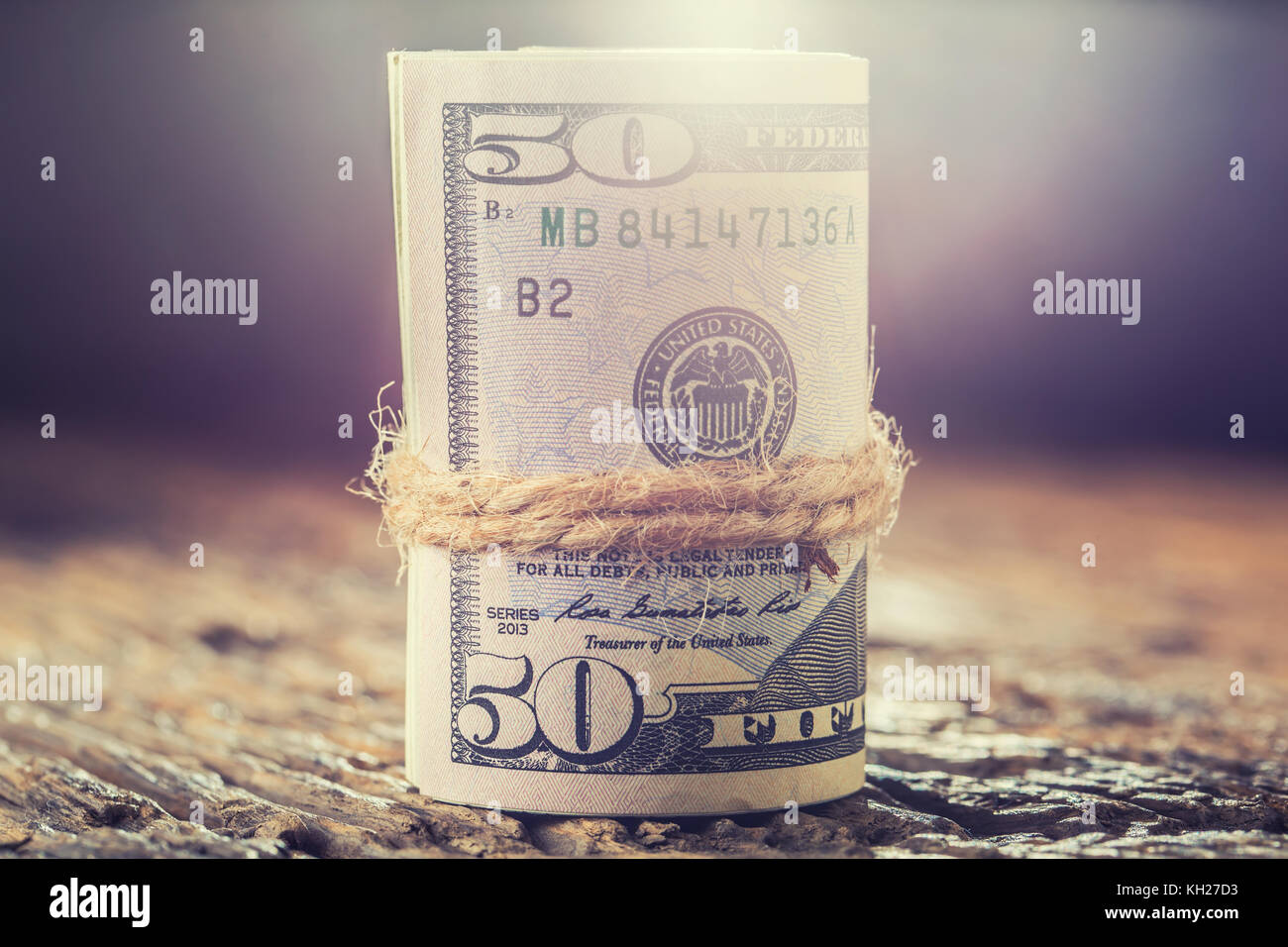 Dollars rolled banknotes closeup. Cash Money American Dollars.Close-up view of stack of US dollars. - Stock Image