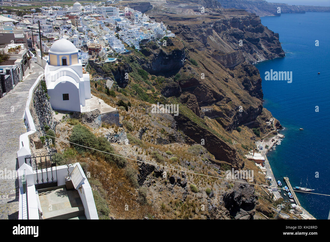 View from the crater edge path down to Thira and the old harbour, Santorin island, Cyclades, Aegean, Greece Stock Photo
