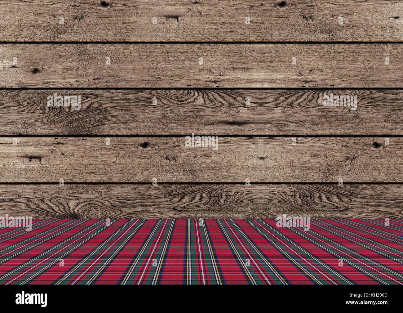 beautiful rustic tradional wooden Christmas background with red and green plaid pattern ground - Stock Image