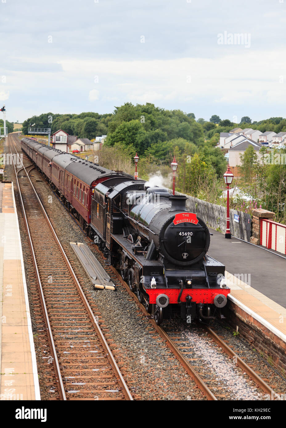 Preserved steam locomotive 45690, Leander heads the Waverley into Appleby station, on the Settle to Carlisle railway. - Stock Image