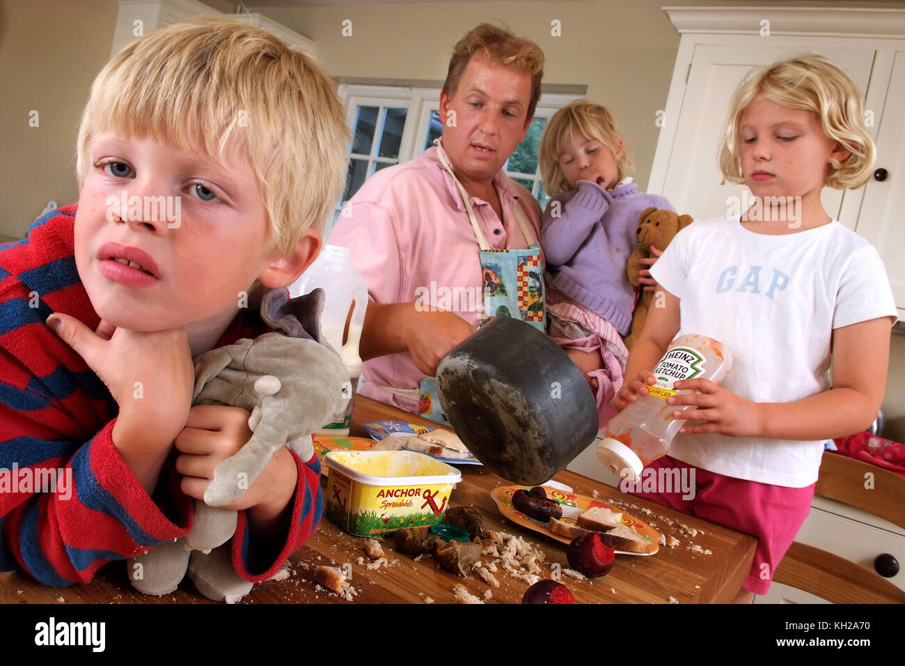 Tim West with George, Anna and Sophie (purple top) - Stock Image