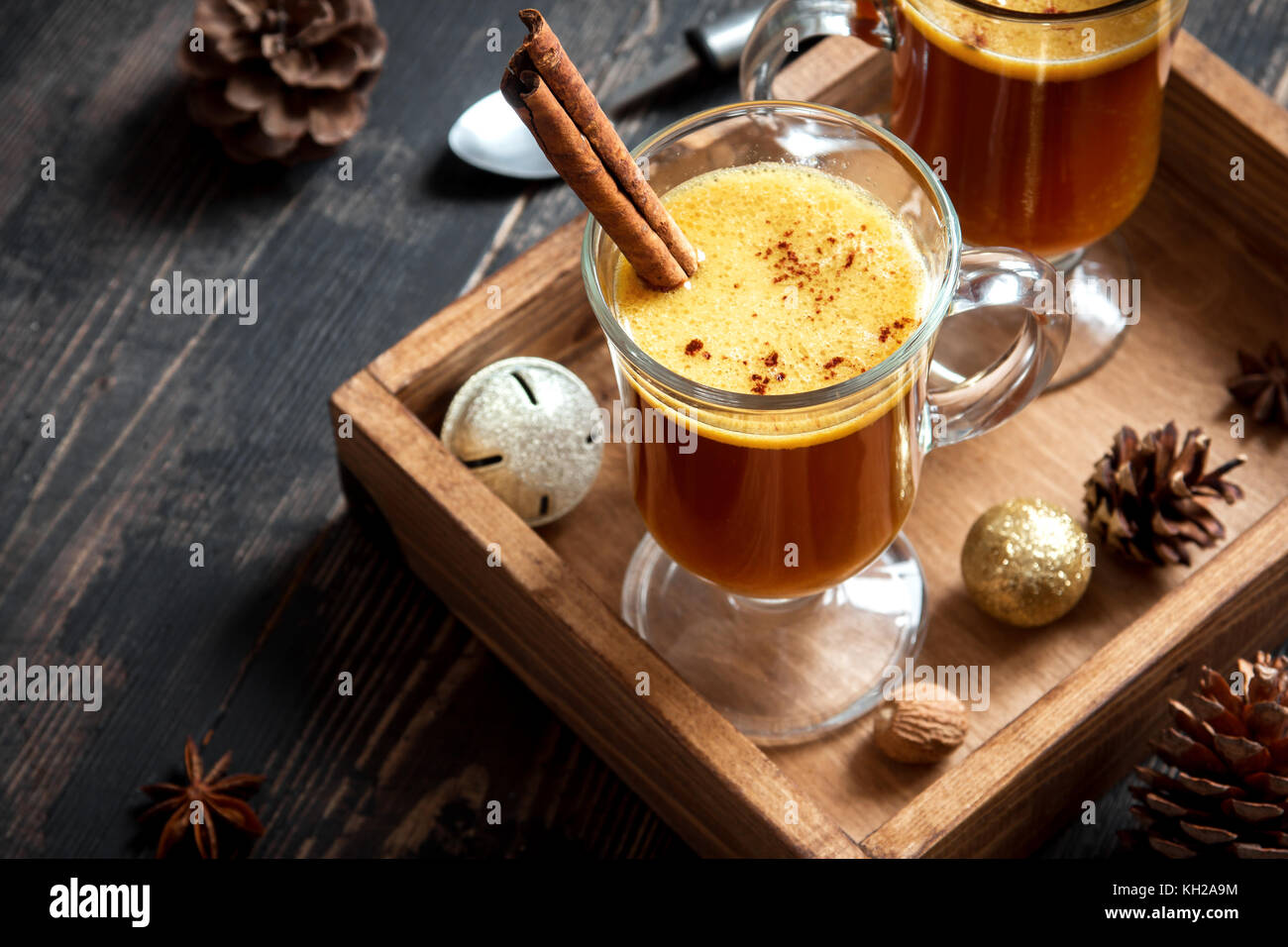 Hot buttered rum cocktail with cinnamon for Christmas and winter holidays. Homemade festive hot Christmas drink. Stock Photo