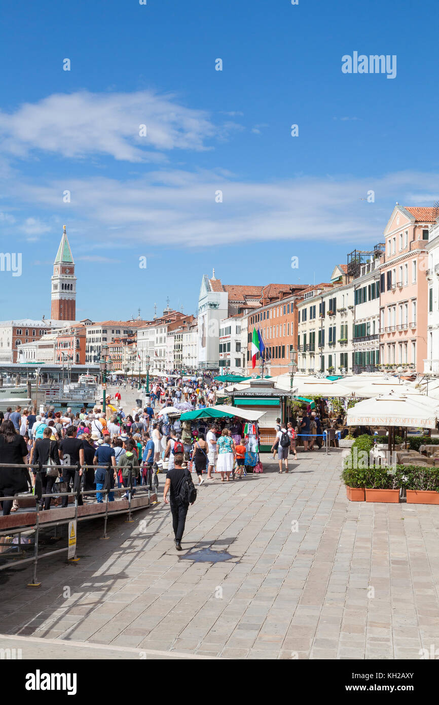 Large crowd of tourists who have just disembarked of a day tour ferry descending on Riva degli Schiavoni, Castello, - Stock Image