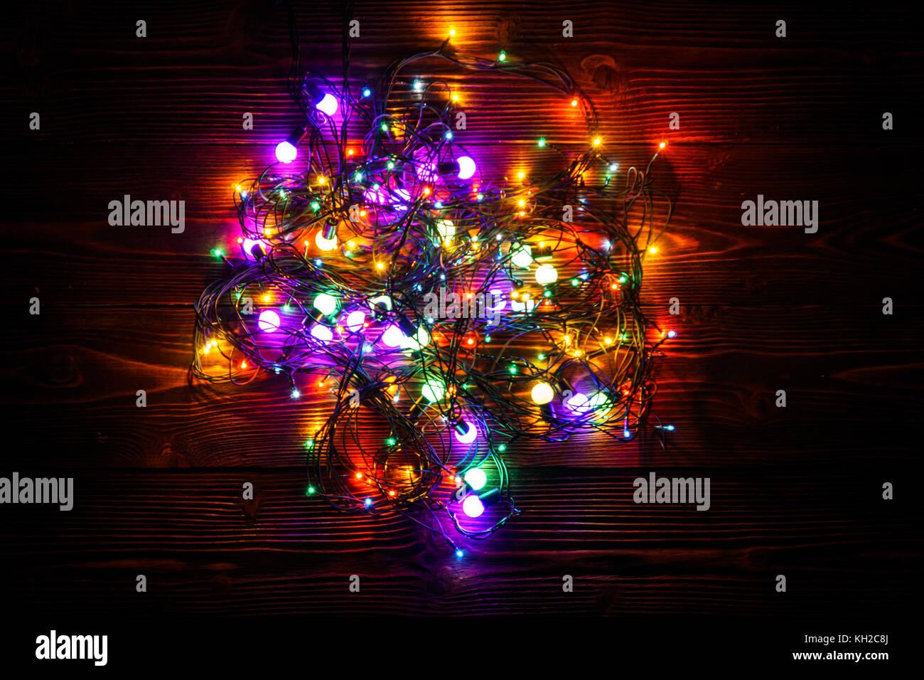 Free Christmas Lights.Wreath And Garlands Of Colored Light Bulbs Christmas