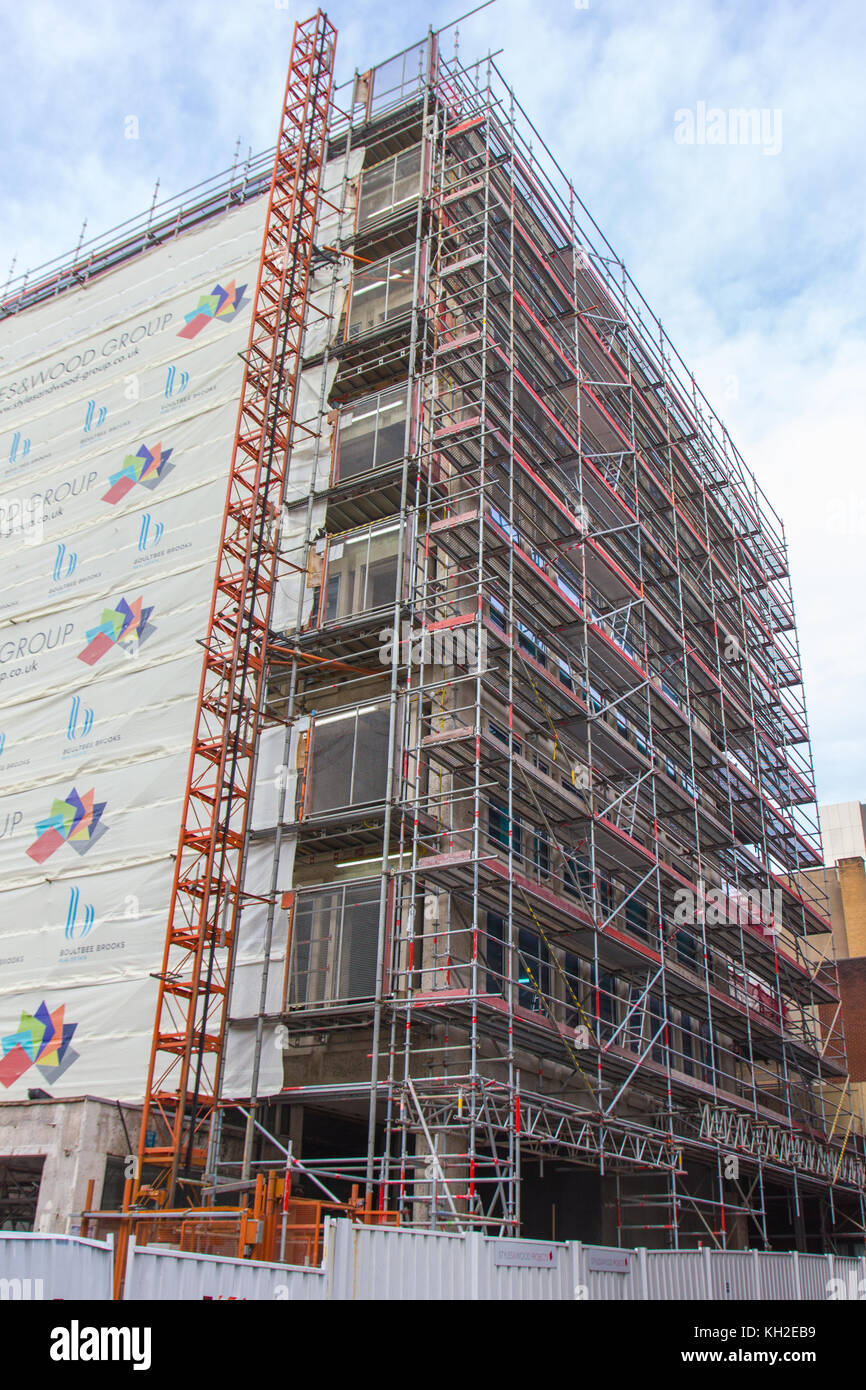 Scaffolding set up for building renovation work as seen from Nicholas Street, Manchester, UK - Stock Image
