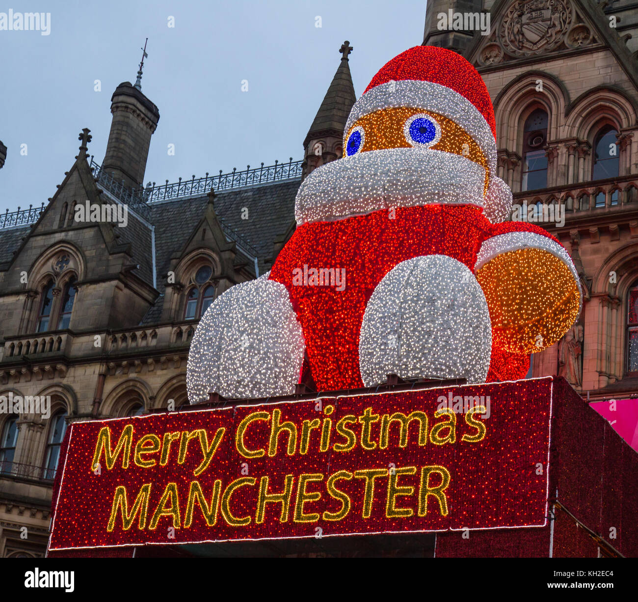 Giant Santa Claus above the Entrance to Manchester Town Hall, UK. Taken on 11 Nov 2017 on the first Saturday of - Stock Image