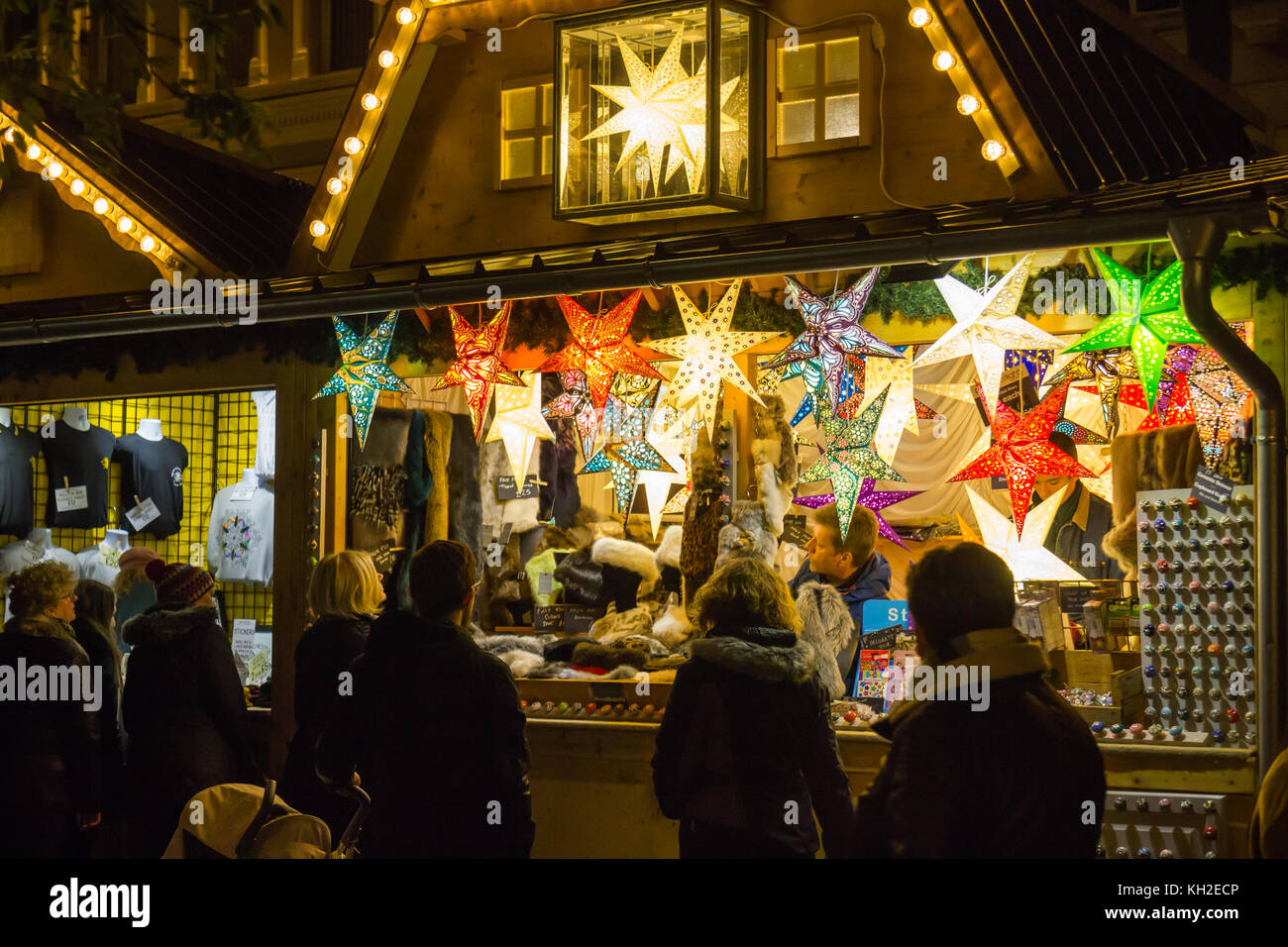 Manchester Christmas Market in St Annes Square, Manchester UK on 11 Nov 2017  A stall sellings large light stars. - Stock Image