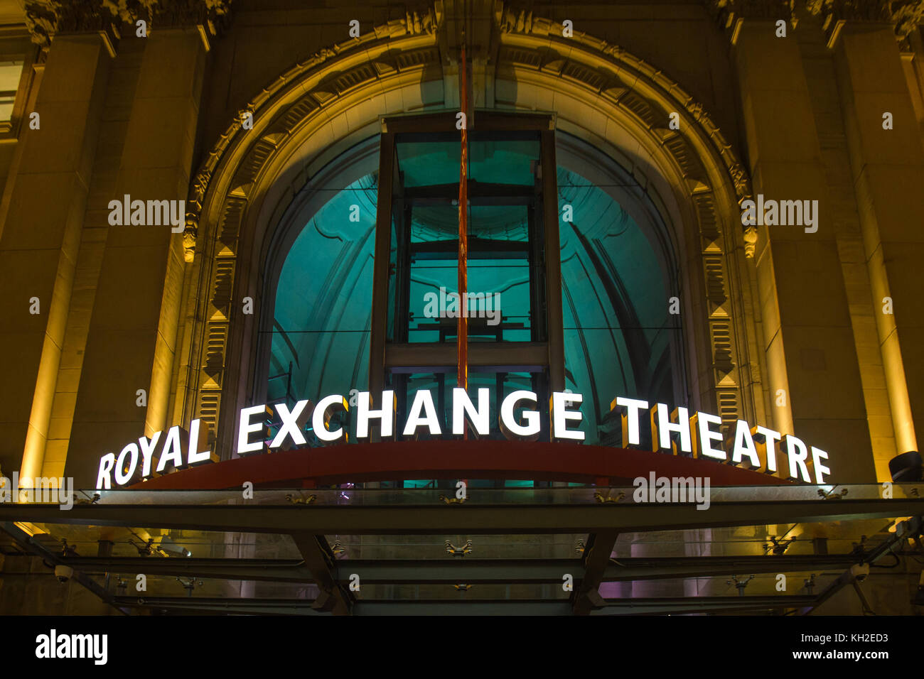 Manchester Royal Exchange Theatre building entrance  lit up at night on St Annes Square, Manchester, UK. Take on - Stock Image