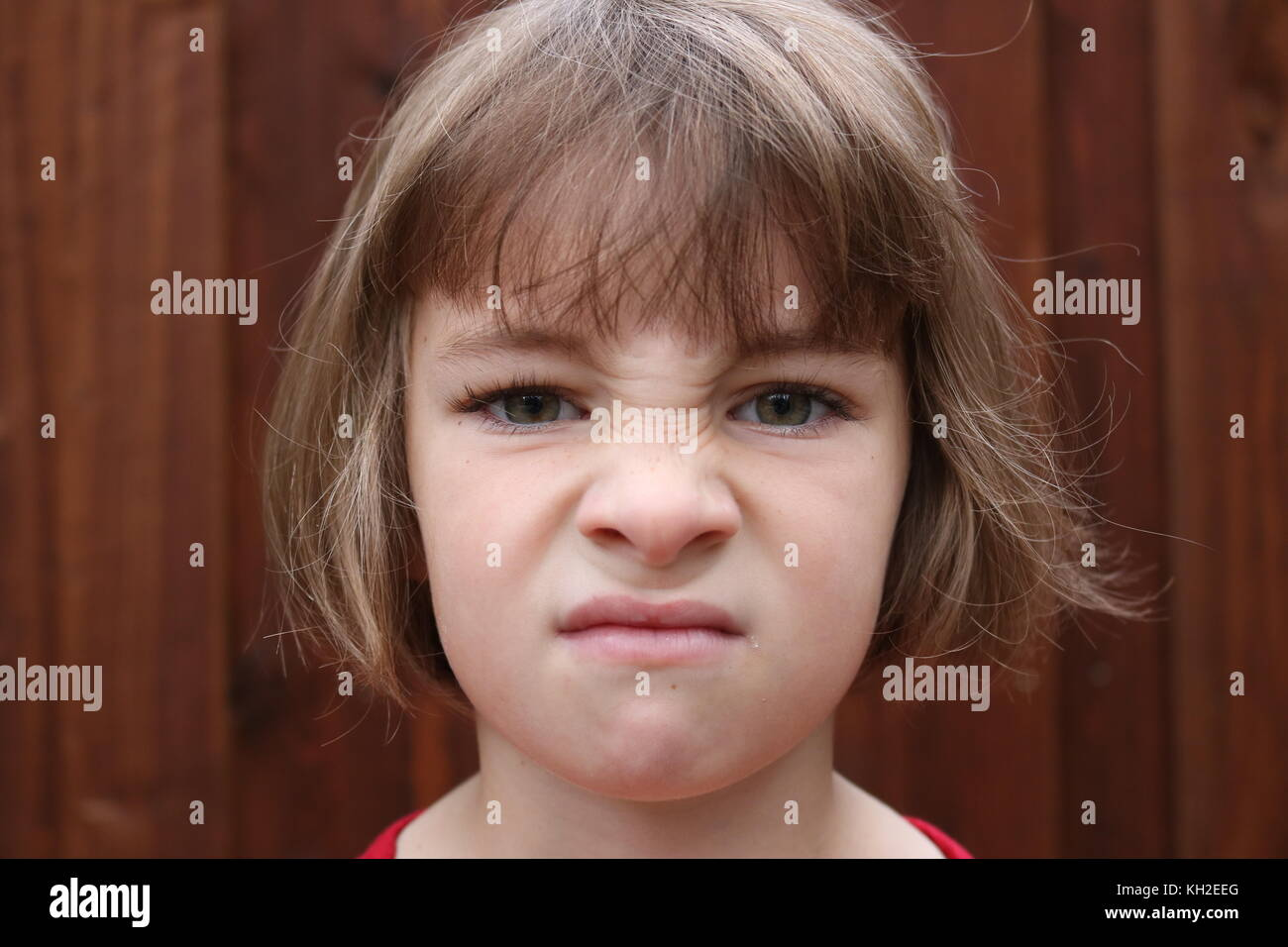 Portrait of an angry little girl - Stock Image