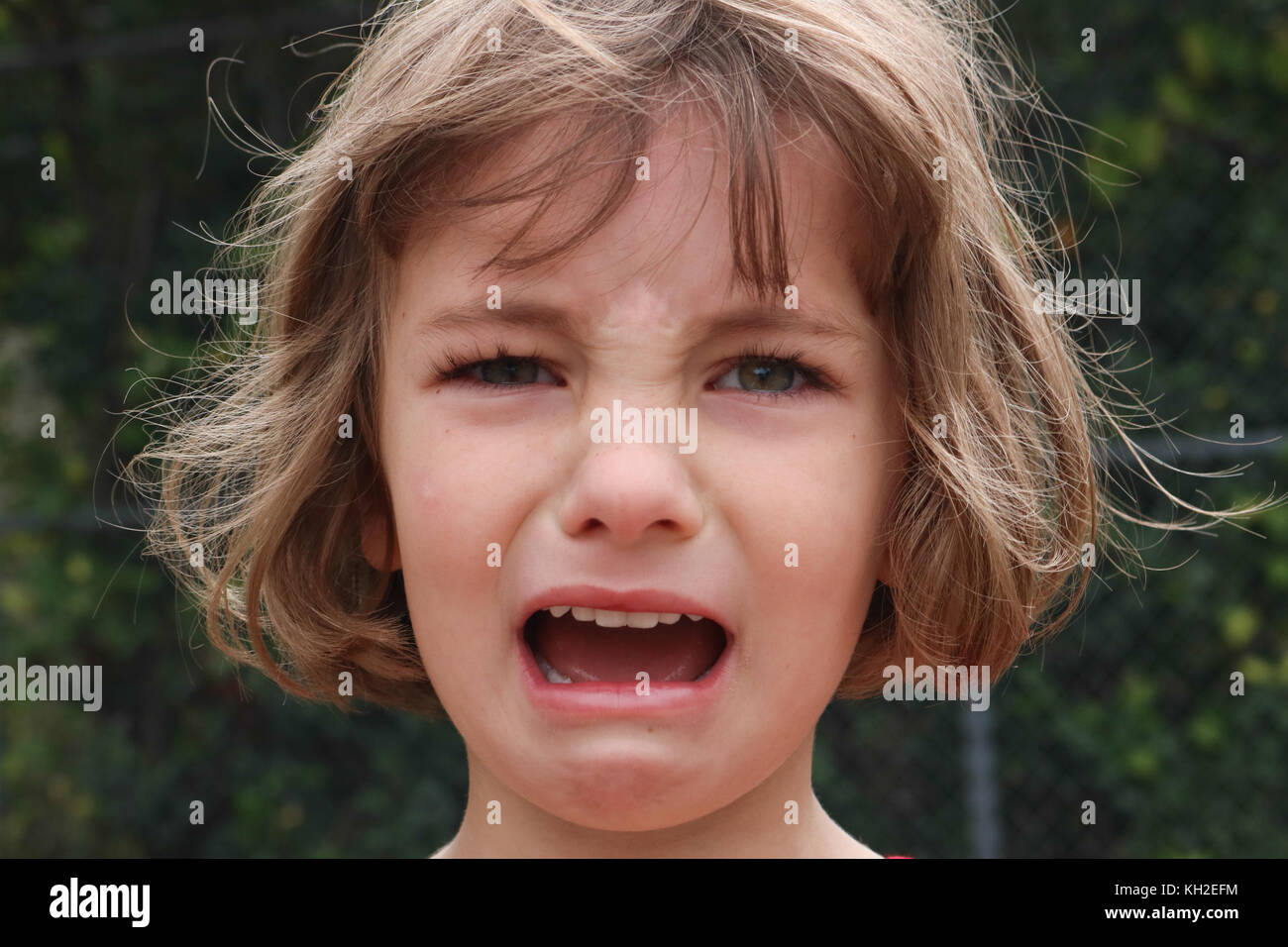 Portrait of a young girl who is very angry and upset - Stock Image