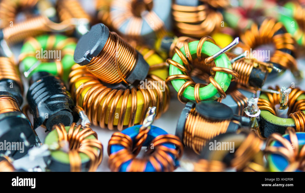 Inductor Stock Photos Images Alamy Circuit Speaker Using An Colorful Coils With Magnetic Core And Copper Winding Background From Inductors Small Depth Of