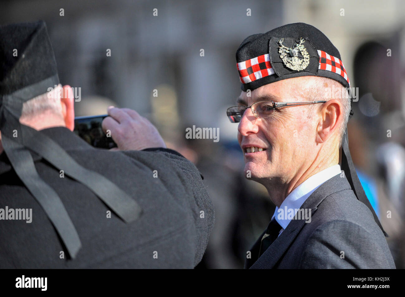London, UK.  12 November 2017.  War veterans take a photo as large crowds gather around Parliament Square and Whitehall Stock Photo