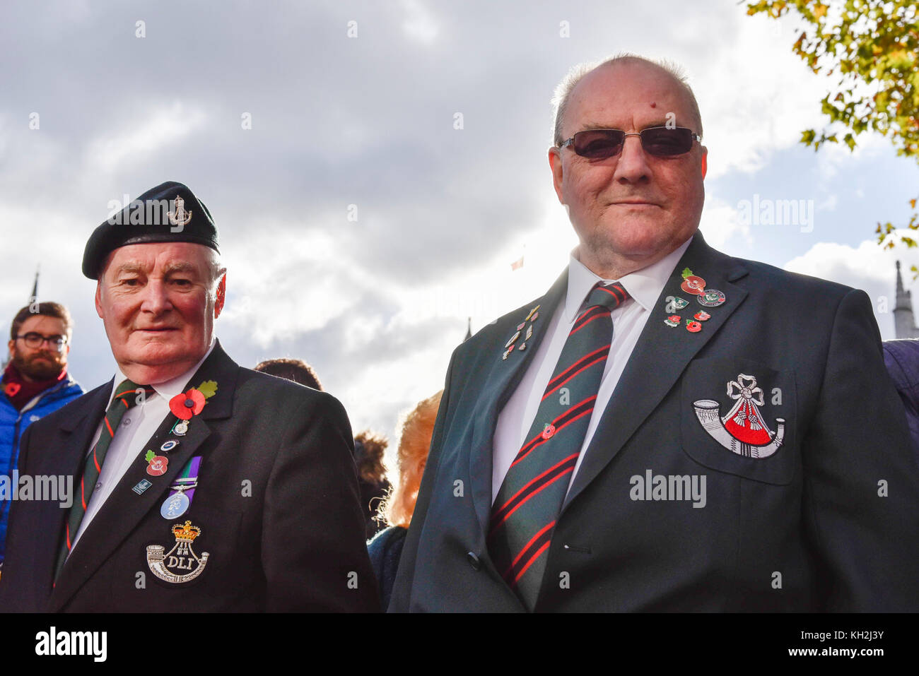 London, UK.  12 November 2017.  War veterans show off their medals as large crowds gather around Parliament Square Stock Photo