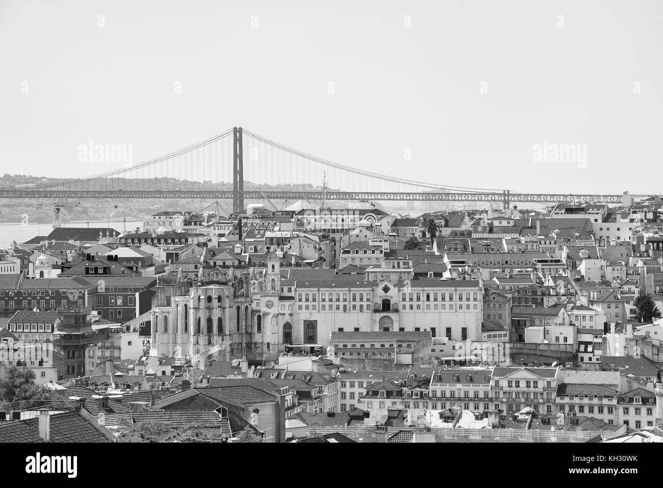 Alfama downtown and the 25 April Bridge in Lisbon, Portugal. - Stock Image