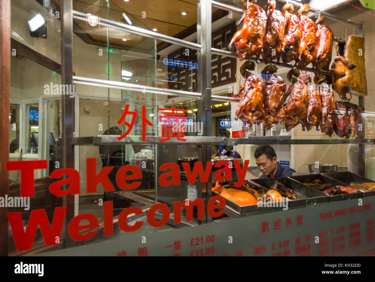 Aromatic Chinese crispy duck on display in China Town, London, England, UK. - Stock Image