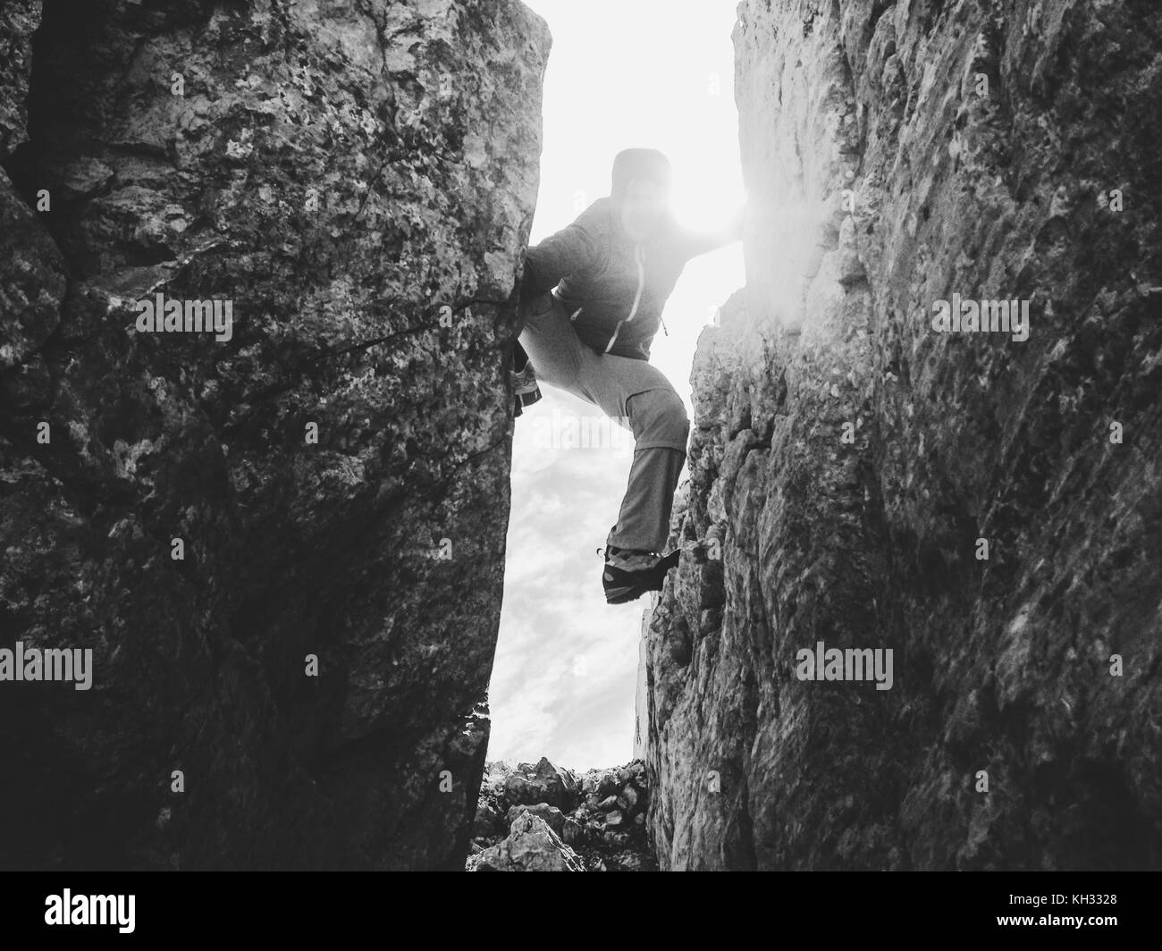 Silhouette of climber in crevasse in black and white. - Stock Image