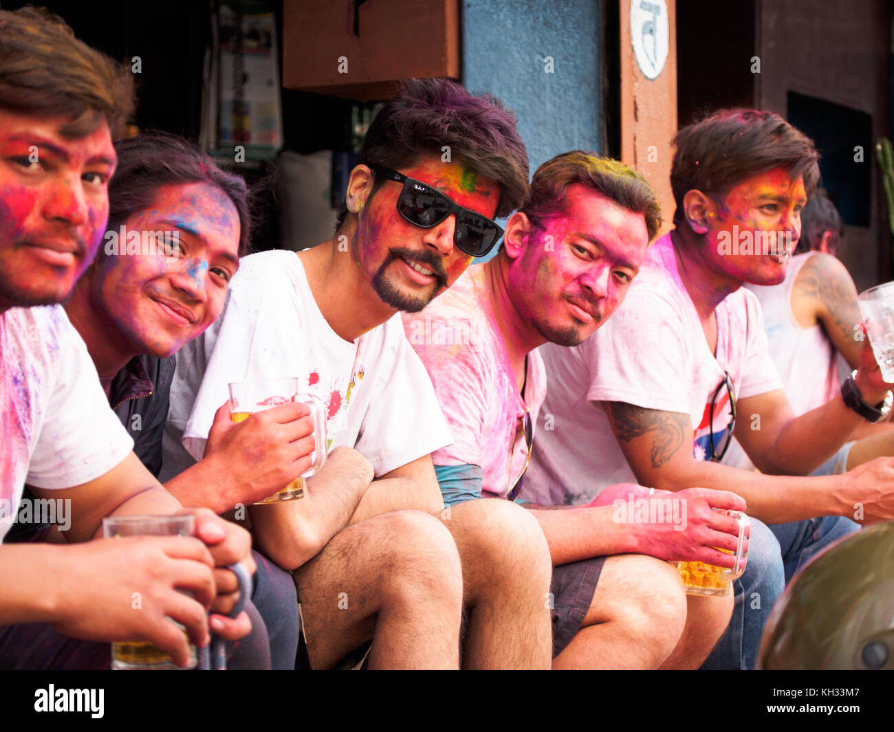 Nepali youths covered with coloured powder after celebrating the Hindu festival Holi in Pokhara, Nepal - Stock Image