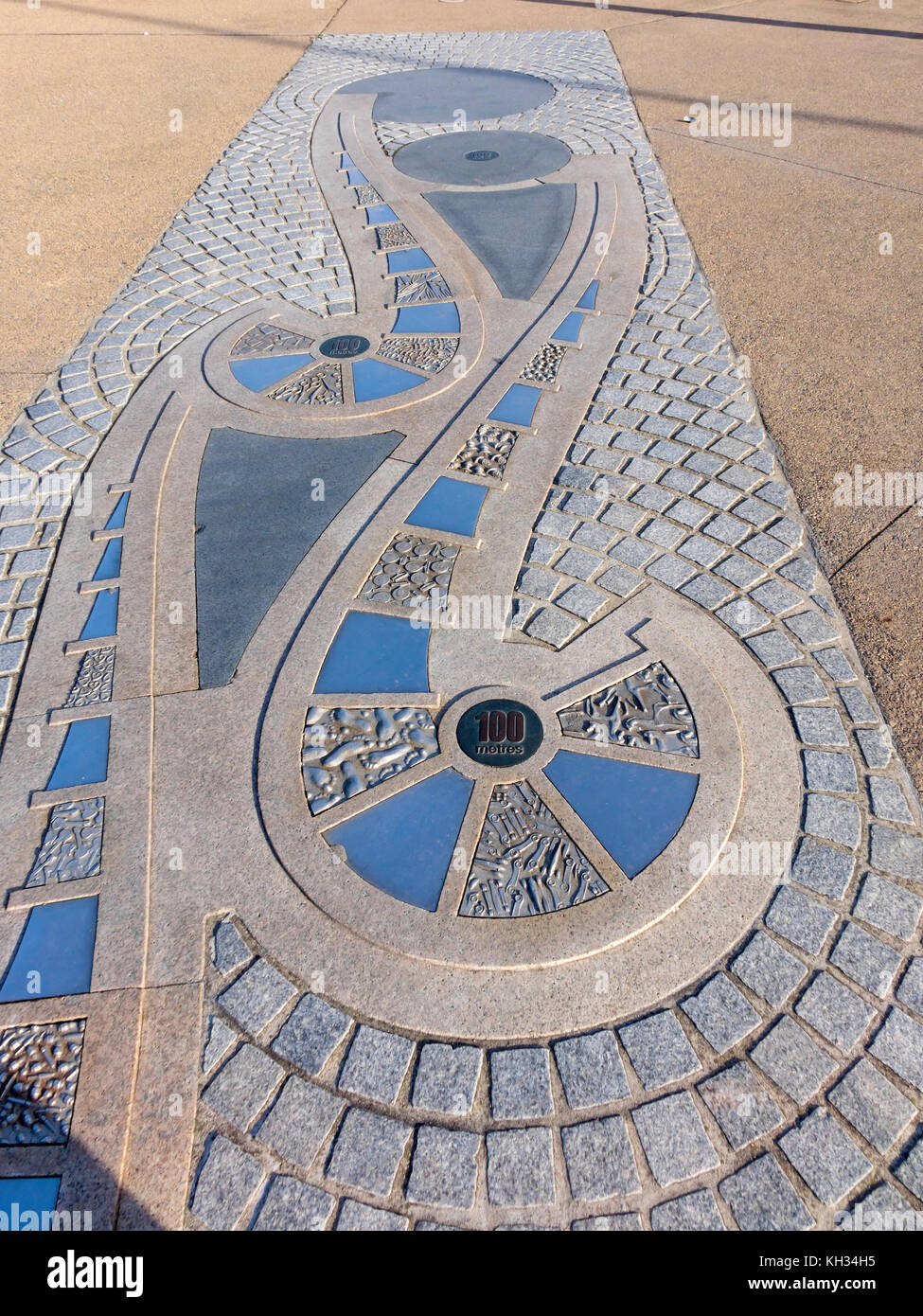 Decorative pavement on the promenade on the Sea Wall at Redcar Cleveland UK this marking the 100 metre point of - Stock Image