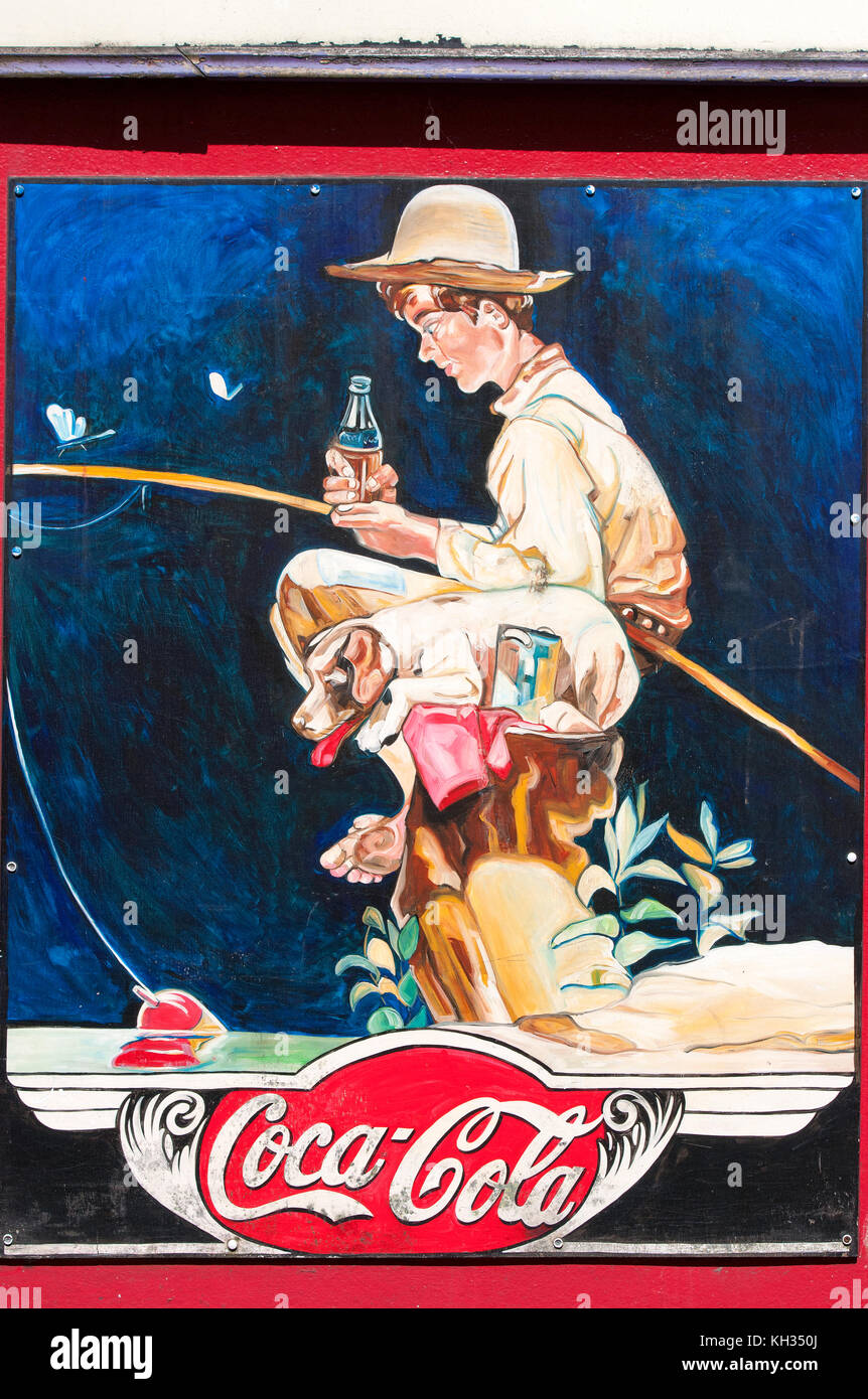 Coca Cola advertisement sign (illustration inspired by a Norman Rockwell's famous painting), Galway, County - Stock Image