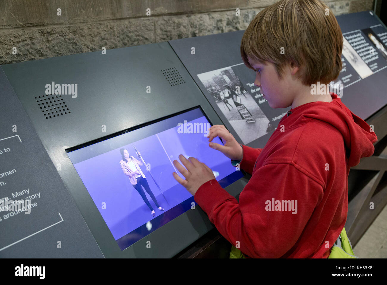 boy using an information monitor inside Wallace Monument, Stirling, Scotland, Great Britain - Stock Image