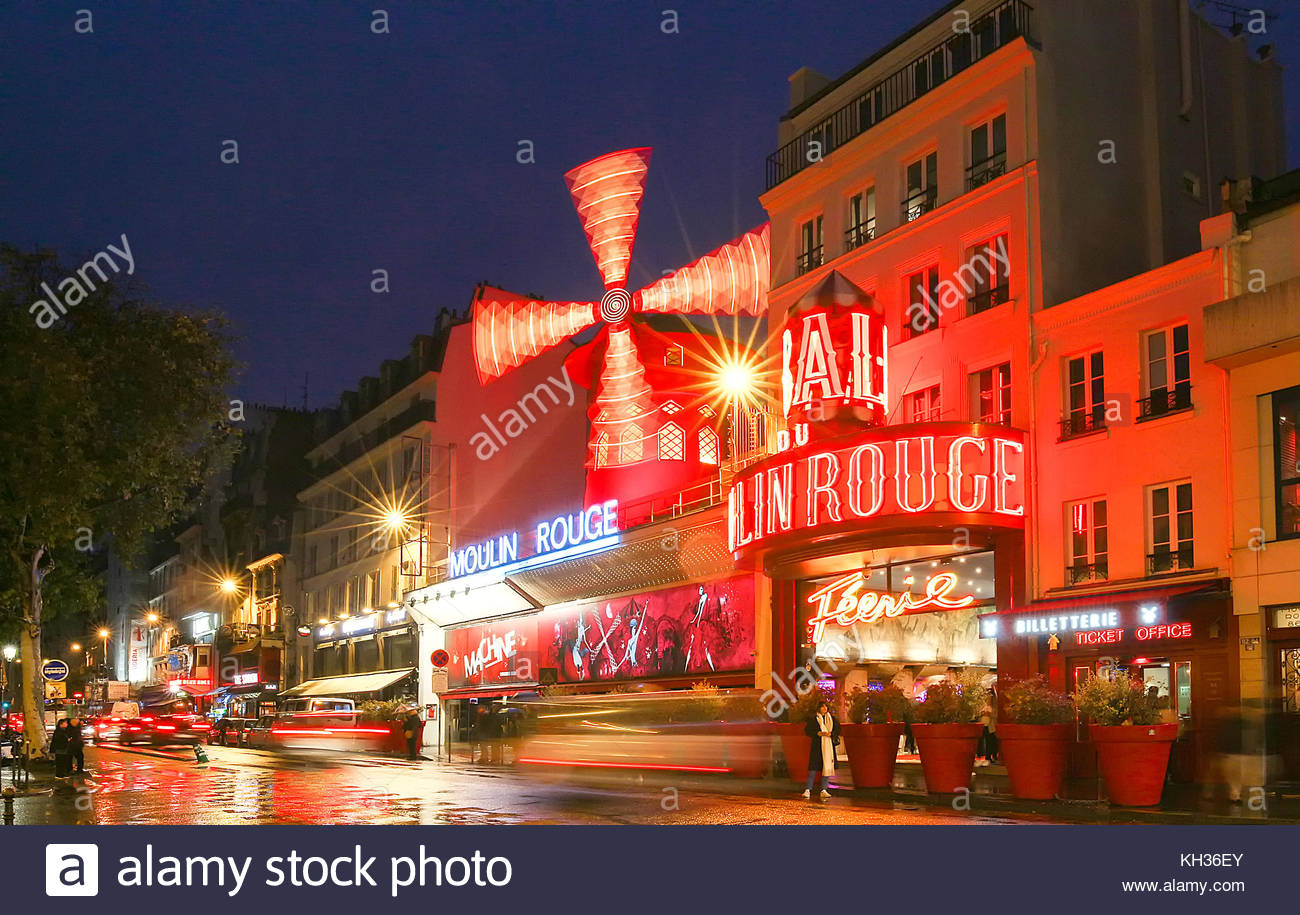 The Moulin Rouge by night, Paris, France. It is a famous cabaret built in 1889, locating in the Paris red-light - Stock Image