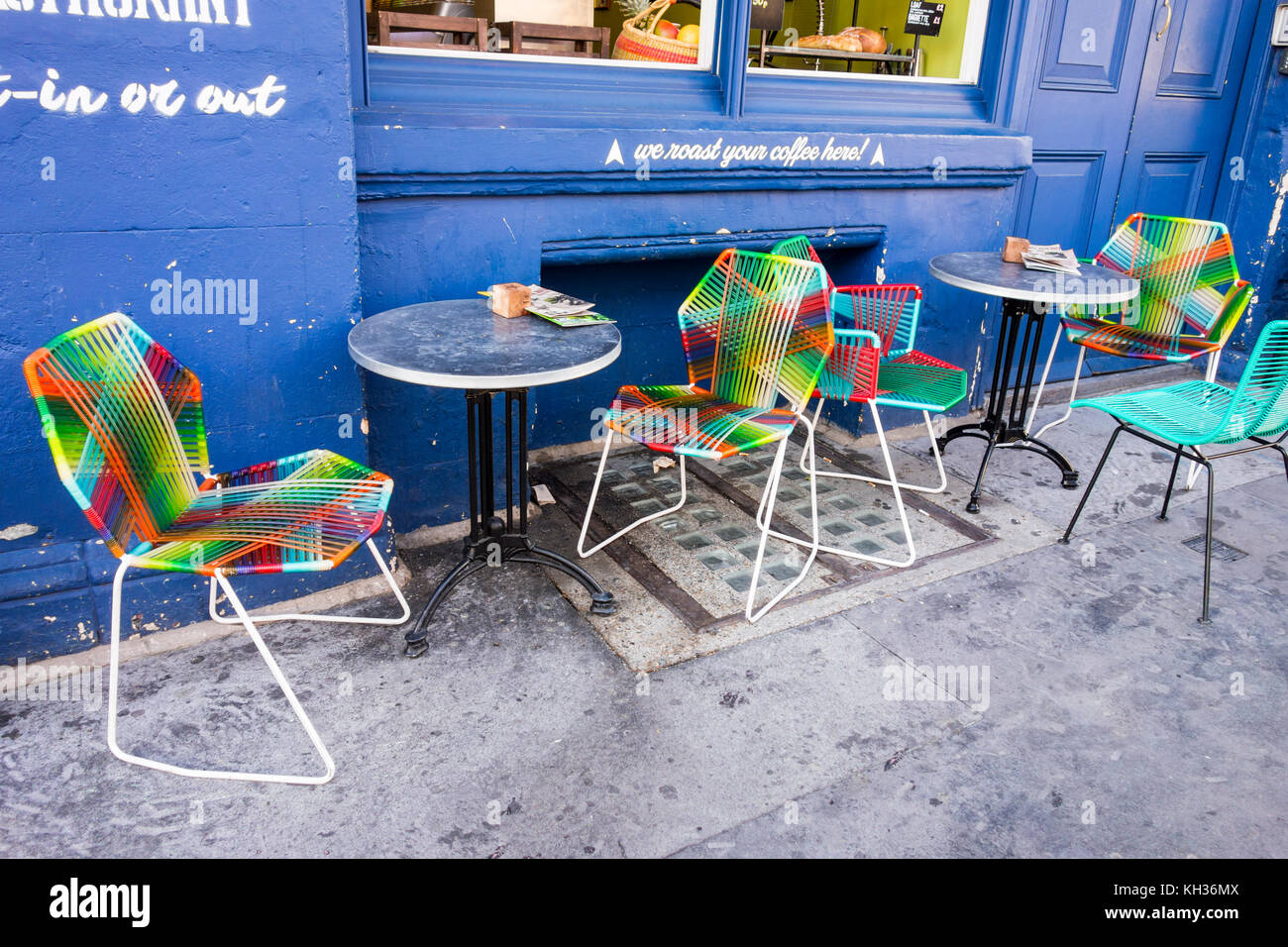 Colourful chairs and tables outside a cafe in Spitafields, City of London, UK - Stock Image