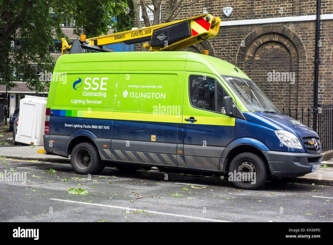 SSE Lighting Services in Islington on a windy day with leaves on the ground, London, UK - Stock Image