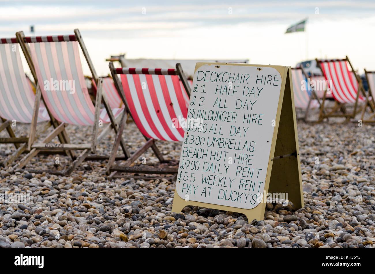 Deckchair hire sign on Beer beach in Devon, UK Stock Photo